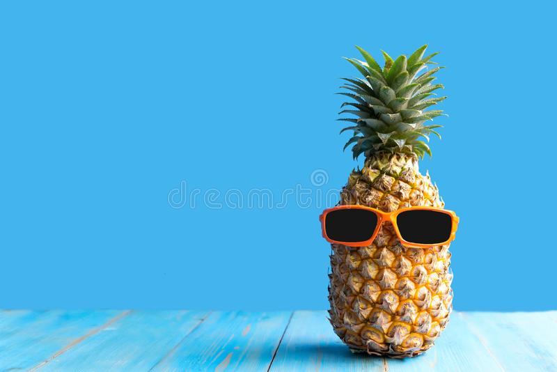 Summer in the party.  Hipster Pineapple Fashion in sunglass bright beautiful color in holiday, Creative art fruit for tropical sty stock photos