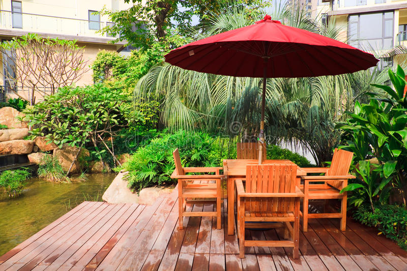 Summer Patio with tables and wooden chairs stock photo