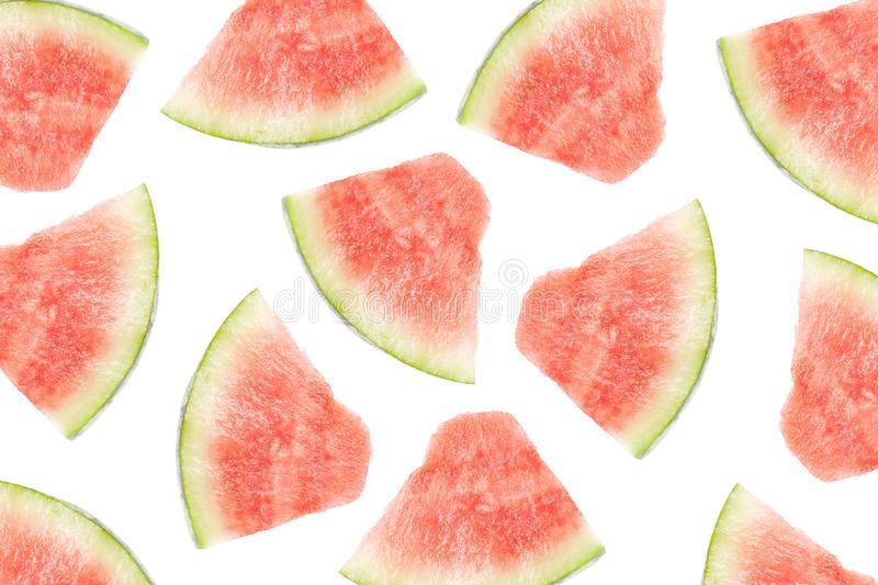 Summer pattern of red fruit watermelon slices on a white isolated background royalty free stock photos