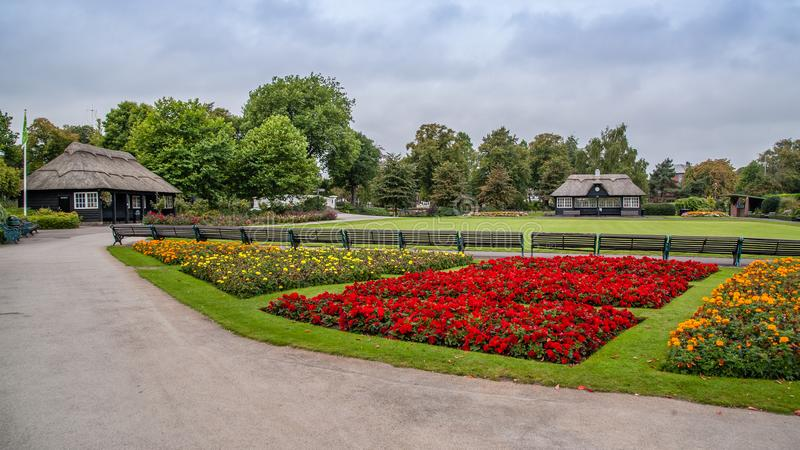 Victoria park in Stafford Staffordshire UK with flowers and pavilion. Summer photograph of the pavilions and bowling green in the town park in Stafford, uk royalty free stock photo