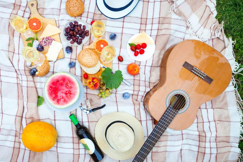 Summer Picnic Basket on the Green Grass. Food and drink concept. Summer Picnic Basket on the Green Grass in italian garden. Food and drink concept. Friends stock photos