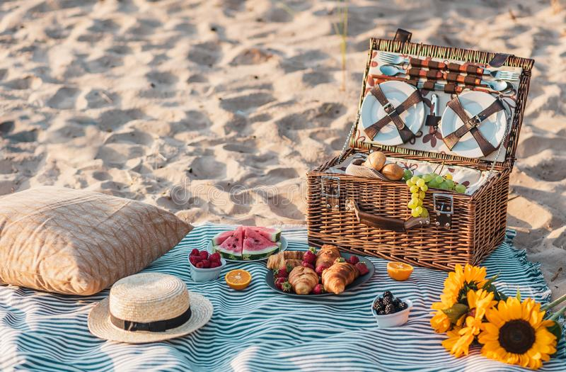 Summer picnic in the beach. Wooden basket with food. Rest time stock photography