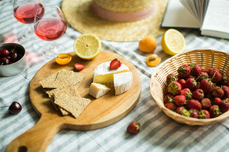 Summer picnic in nature, fruit, berries, cheese stock photo
