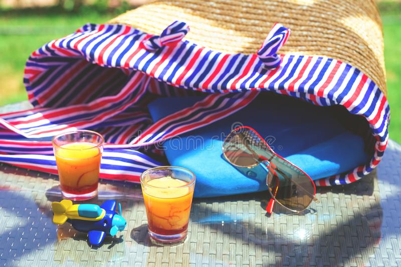 Summer picnic with straw bag and desserts royalty free stock photo