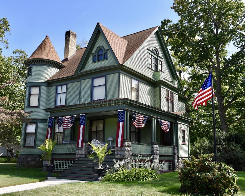 Dowagiac Queen Anne. This is a Summer picture of the acrid Field-Whiteley House located in Dowagiac, Indiana on Cass County. This 2 12 story framed house stock images