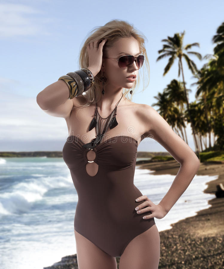 Summer picture of a blonde girl with sunglasses stock photography