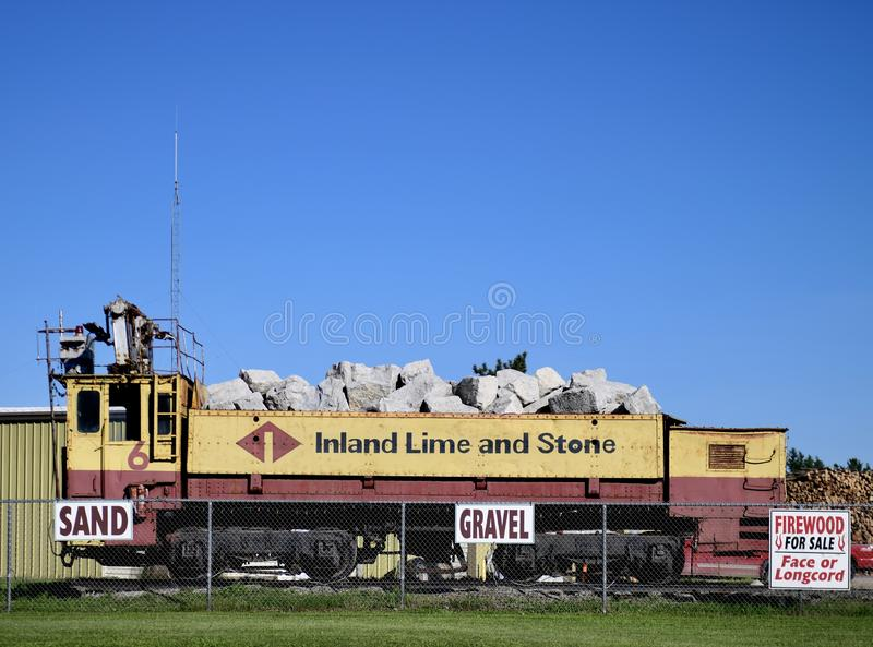 A Lime Rock Transport Railroad Car. This is a summer picture of a lime rock transport railroad car in the Upper Peninsula of Michigan located in Gulliver stock photos