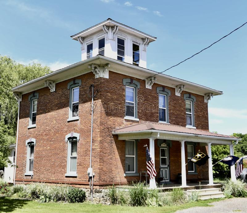 Somerset Italianate. This is a Summer picture of a three-story brick house located in Somerset, Michigan in Wayne County. This house built in 1893, it is an stock photography