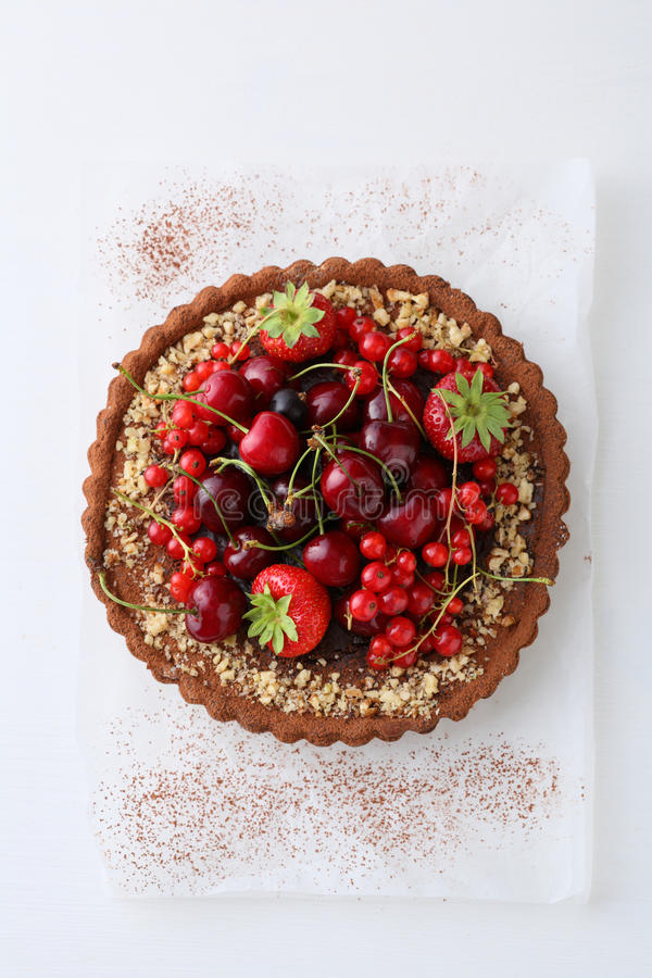 Summer pie with fresh berries on white wood. Food above royalty free stock images