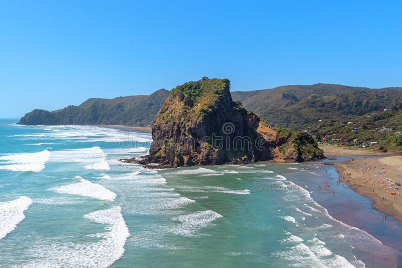 Summer at Piha beach with Lion Rock, New Zealand. Summer at Piha beach with Lion Rock, near Auckland, New Zealand royalty free stock photo