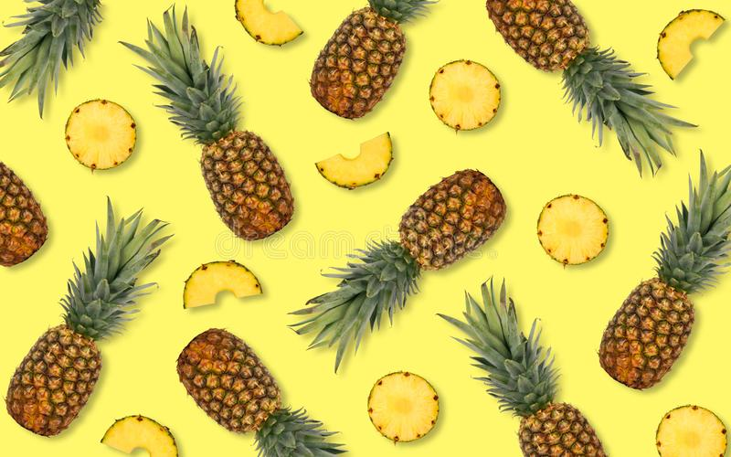 Summer pineapple fruit pattern on a yellow background. Summer pineapple fruit pattern on a bright yellow background royalty free stock image