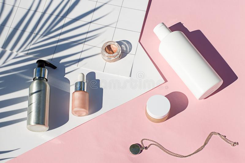 Summer pink cosmetics flat lay . Top view beauty composition stock photography