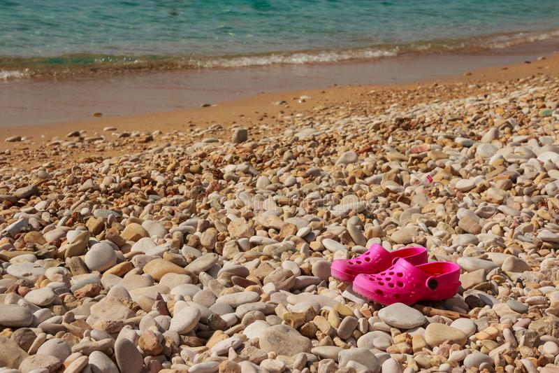 Summer pink Shoes for kids, Children`s slippers, beach fashion for baby, Colorful of Sandals shoes for girl on beach. Summer pink Shoes for kids, Children`s stock photo
