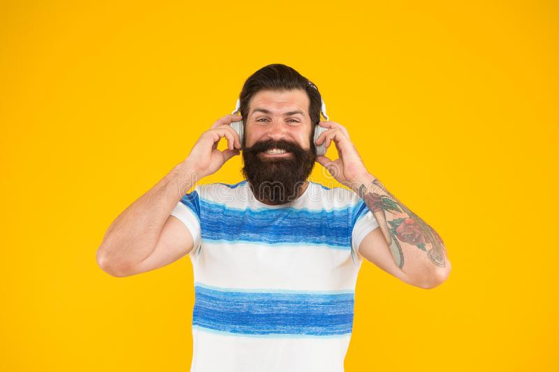 Summer playlist. Music for summer vacation. Guy dressed striped shirt on summer vacation. Melody for relax. Man bearded. Hipster with mustache long beard royalty free stock photography