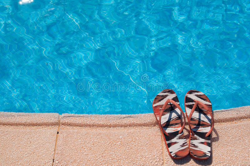 Summer pool. And slippers - vacation concept royalty free stock photography