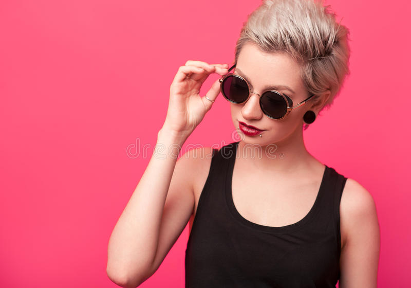 Summer portrait of an attractive young woman in sunglasses royalty free stock photo