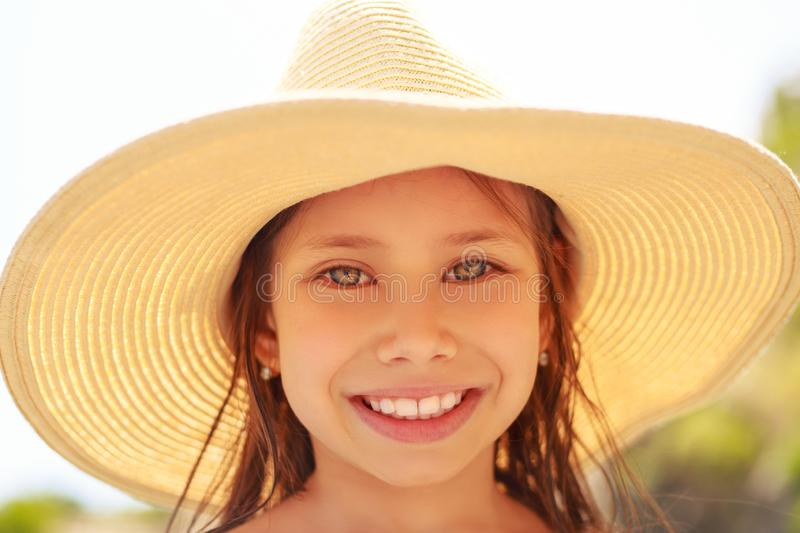 Summer portrait, beautiful young woman wearing straw hat royalty free stock photos
