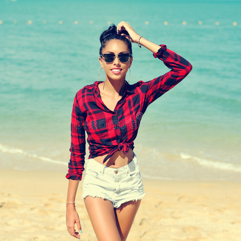 Summer portrait of young sensual tanned woman royalty free stock photography