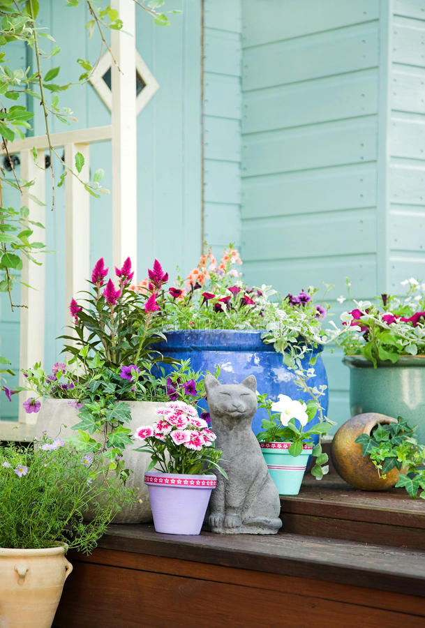 Summer potted flowers and garden shed royalty free stock photography