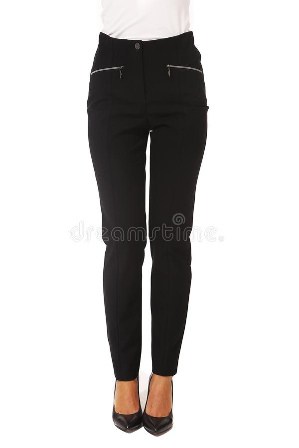 Summer printed white cotton trousers on model legs with white stiletto heels. Black official formal classical trousers on model legs with white stiletto heels royalty free stock image