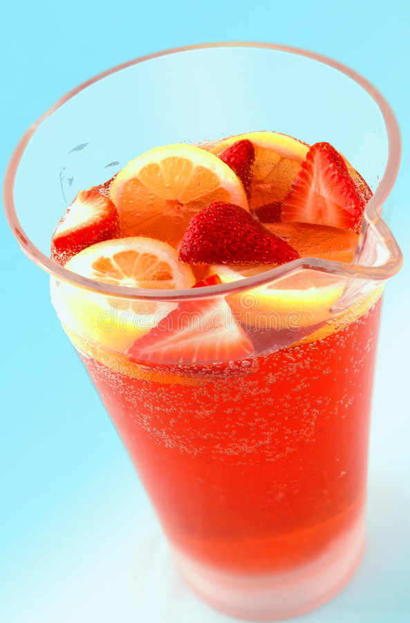 Summer Punch. Summertime punch in a pitcher with strawberries and lemons royalty free stock photo