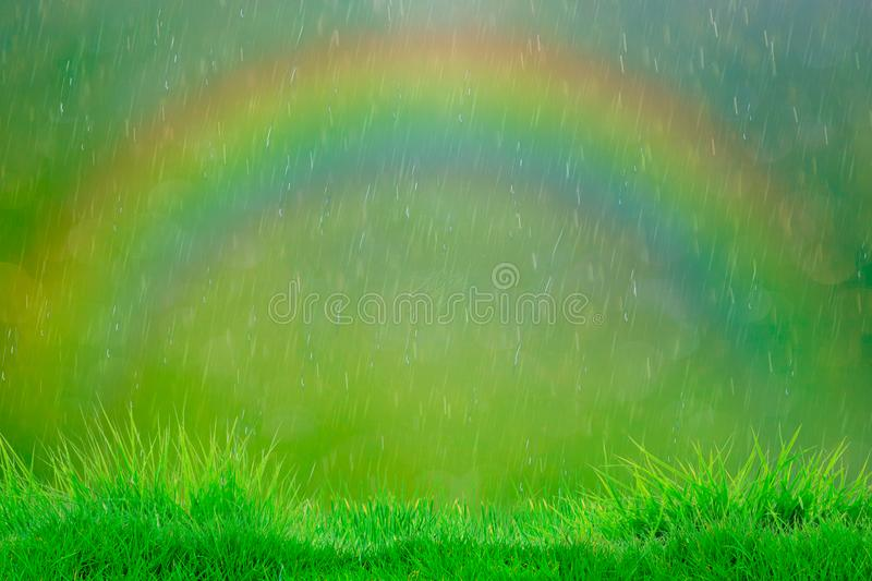 Summer rain. Abstract natural backgrounds with rainbow royalty free stock photos