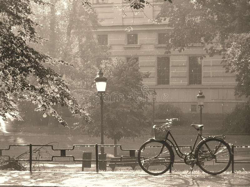 Summer rain in sepia. Bike in the rain in stockholm, sweden stock images
