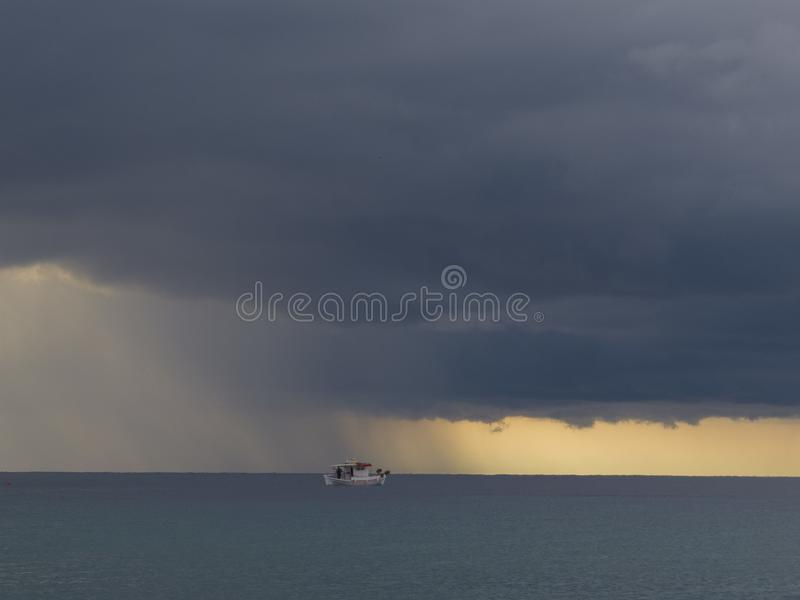 Summer rain upon a small ship in the sea. Thassos, Greece royalty free stock images