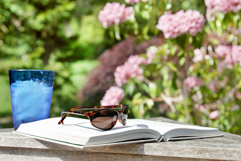 Download Summer reading outside stock photo. Image of greenery - 21422230