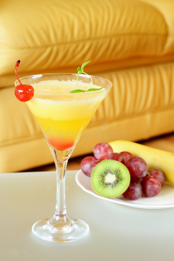 Summer recreational drink. From the mango with cherry and fruits still-life royalty free stock photos
