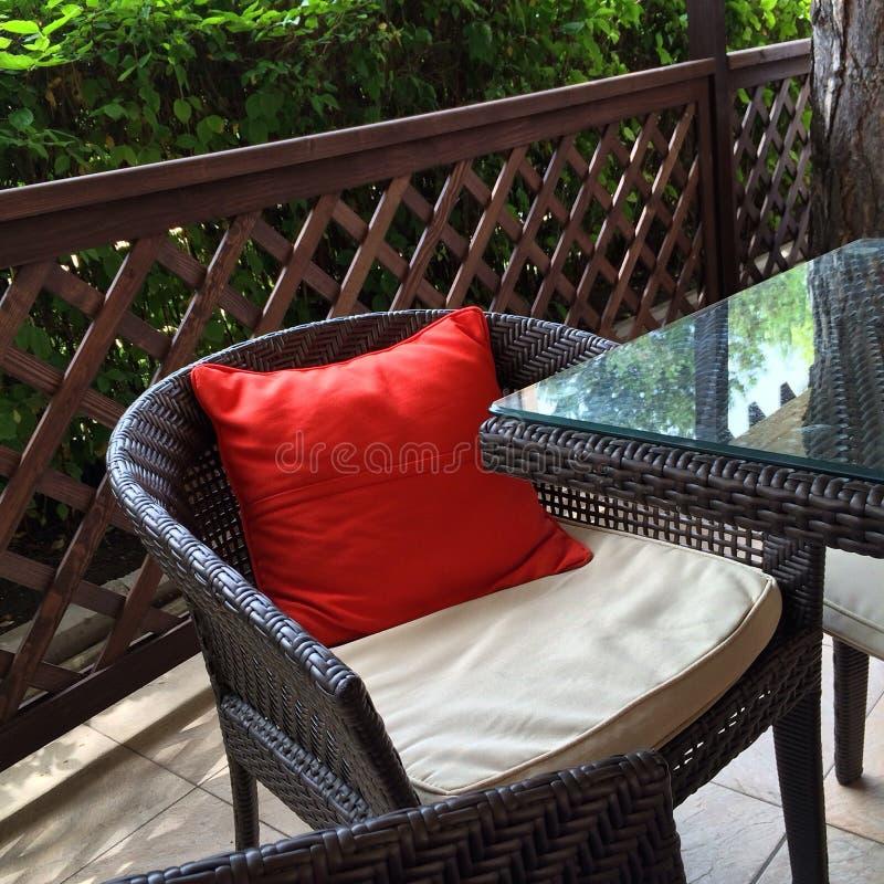 Summer. Red pillow Black Sea armchair stock photo