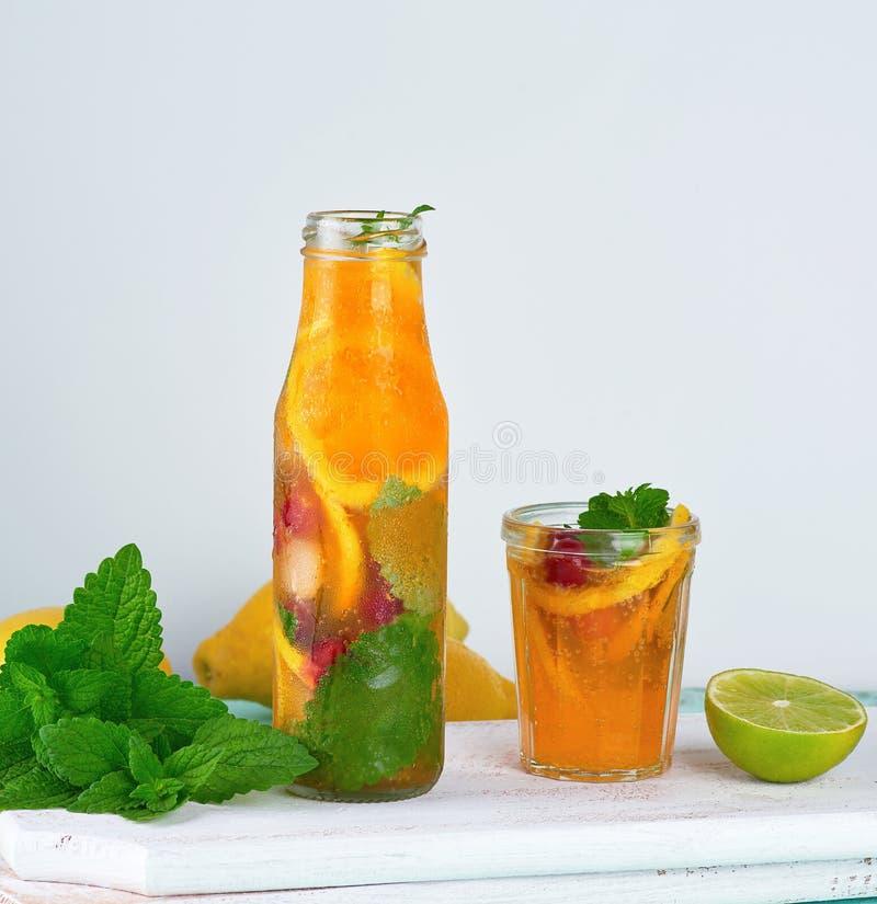summer refreshing drink lemonade with lemons, cranberry, mint leaves stock images