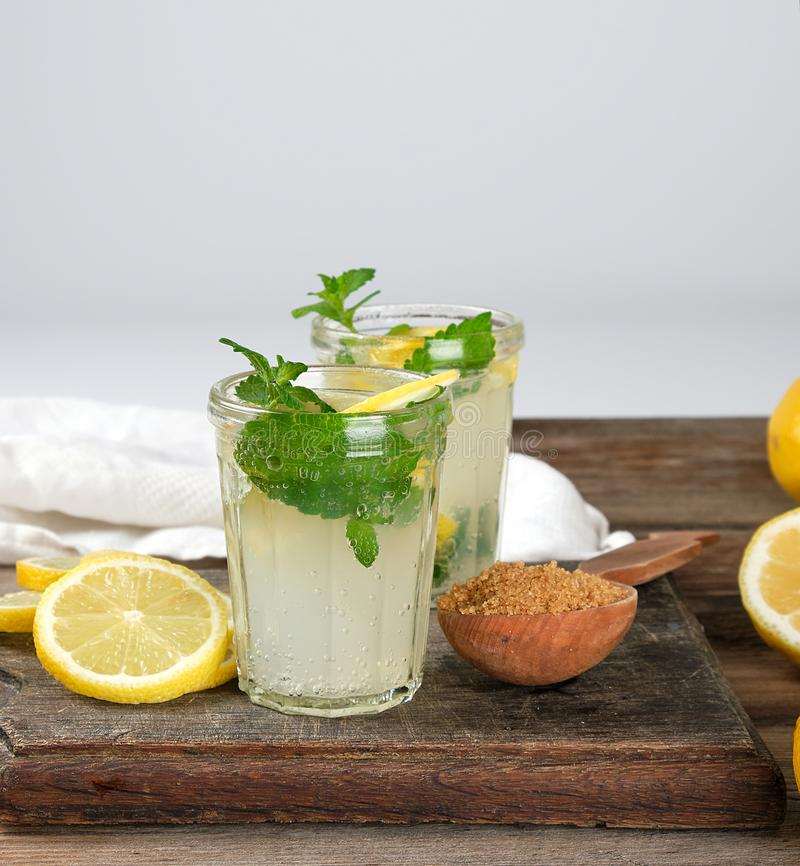 summer refreshing drink lemonade with lemons, mint leaves in a glass stock image