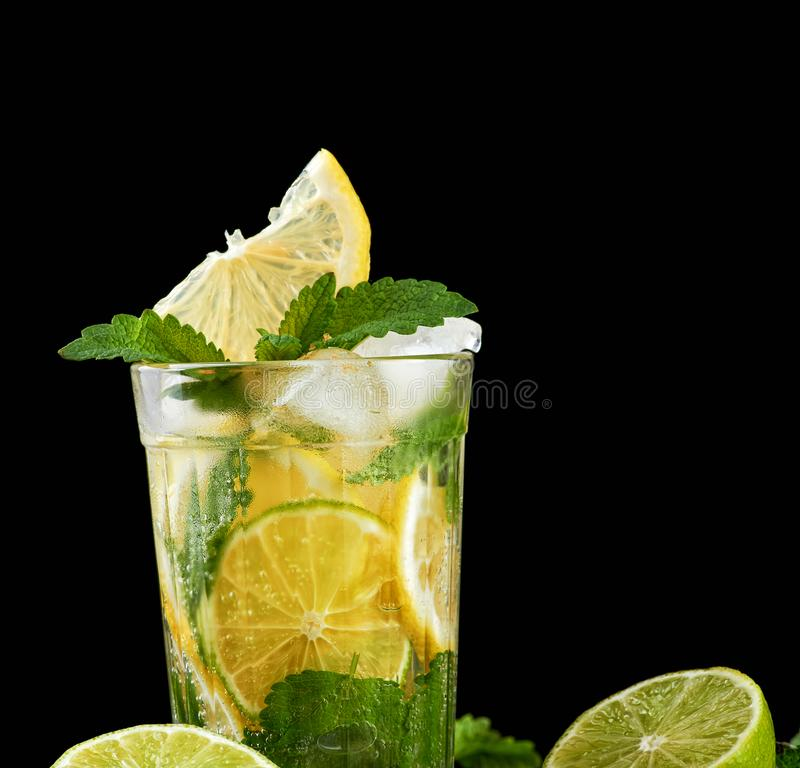 summer refreshing drink lemonade with lemons, mint leaves, ice cubes and lime in a glass stock image