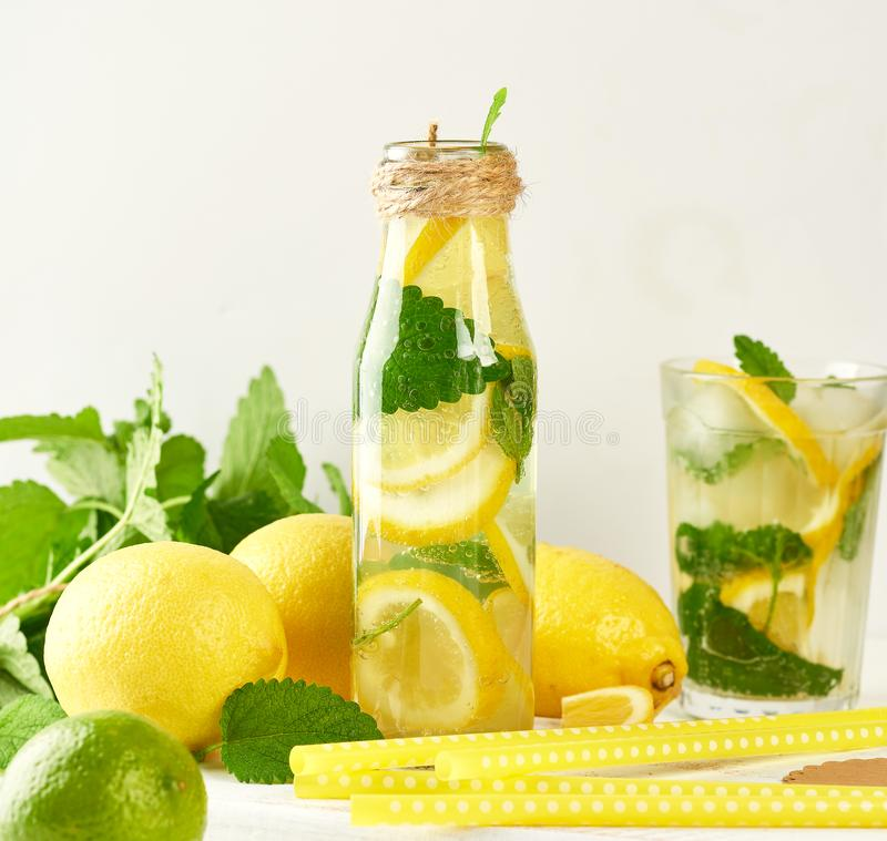 summer refreshing drink lemonade with lemons, mint leaves stock images