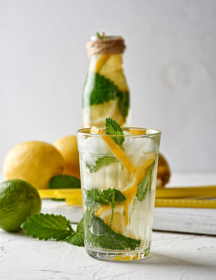 summer refreshing drink lemonade with lemons, mint leaves, lime in a glass royalty free stock photography