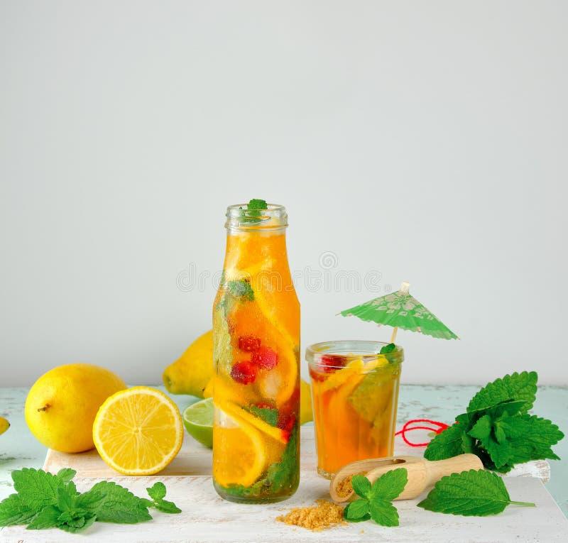 summer refreshing drink lemonade with lemons, mint leaves stock image