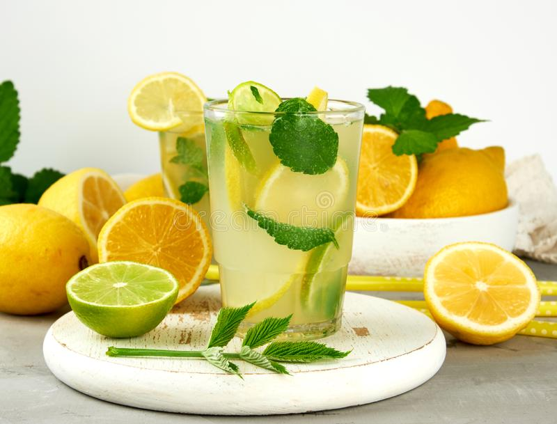summer refreshing drink lemonade with lemons, mint leaves, lime in a glass royalty free stock photos