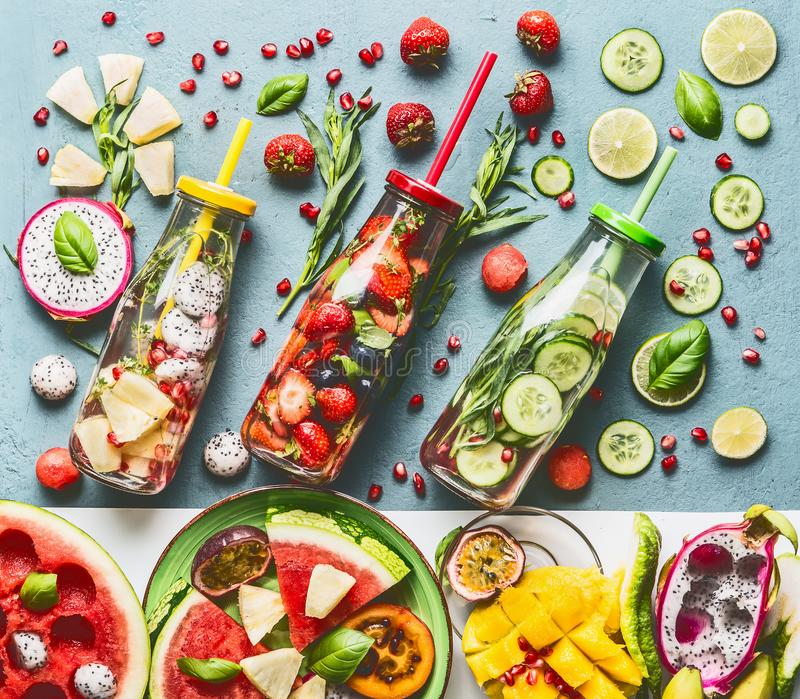 Summer refreshing and extra hydrating infused water in bottles with ingredients, top view. Various fruits and berries water flavor combinations. Summer drinks royalty free stock photo