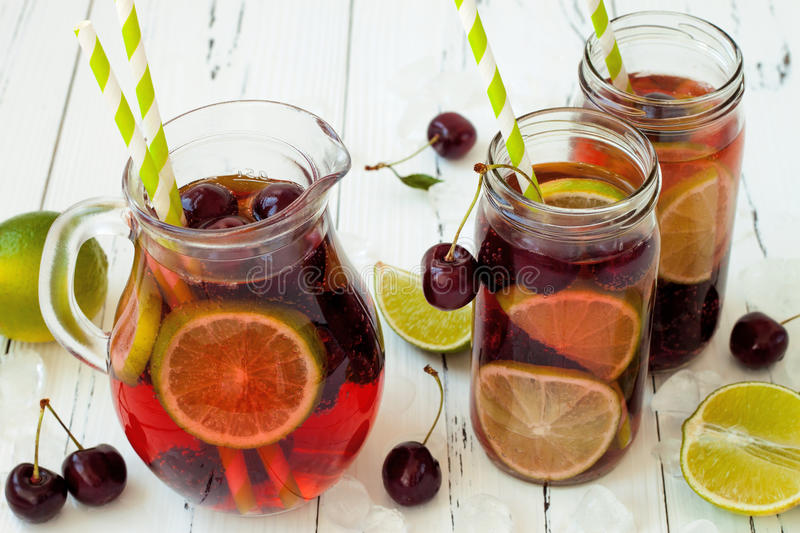 Summer refreshing homemade lemonade with cherry and lime stock images