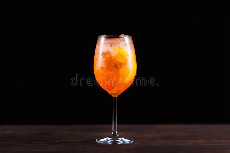 Summer refreshing iced aperitif cocktail with orange bitter and royalty free stock photo