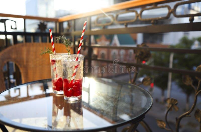 Summer refreshing lemonade with rasberry on a balcony of terrace stock photos