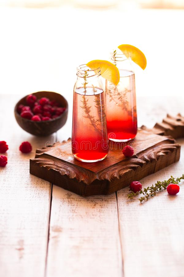Summer refreshing non-alcoholic cocktails. Fruit drinks. Raspberry homemade lemonade with fresh organic rosemary and lemon. On stock photos
