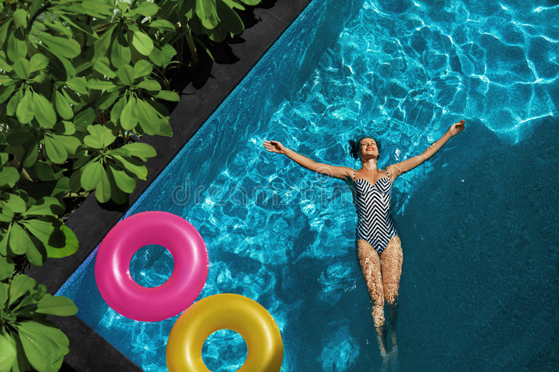 Summer Relax. Woman Floating, Swimming Pool Water. Summertime Holiday royalty free stock image