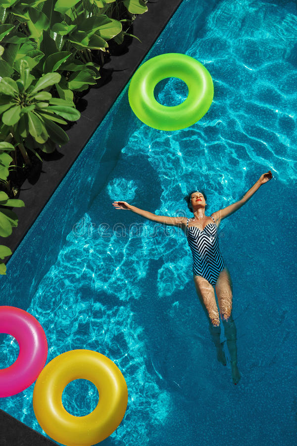Summer Relax. Woman Floating, Swimming Pool Water. Summertime Holidays royalty free stock photography