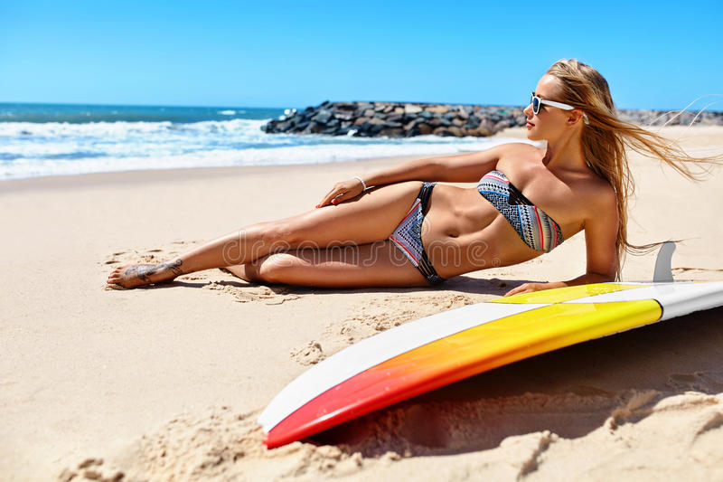 Summer Relaxation On Holidays Vacation. Healthy Woman On Beach. stock photos