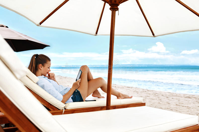 Summer Relaxation. Woman Reading, Relaxing On Beach. Summertime royalty free stock images