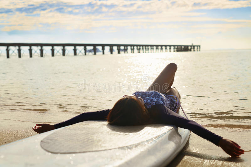 Summer Relaxation. Woman Relaxing On Beach. Lifestyle, Freedom,. Summer Relaxation. Healthy Happy Woman With Fit Body Relaxing On Beach, Lying On SUP, Surf Board royalty free stock photo