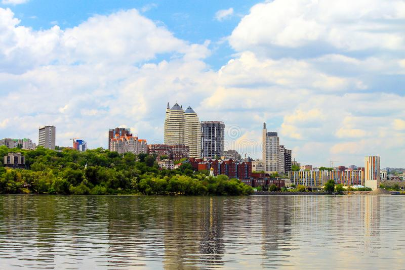 Summer river landscape on a cloudy day. View of the Dnieper River, buildings, skyscrapers. And Monastic Island in the Ukrainian city of Dnipro, Dnepropetrovsk royalty free stock photos