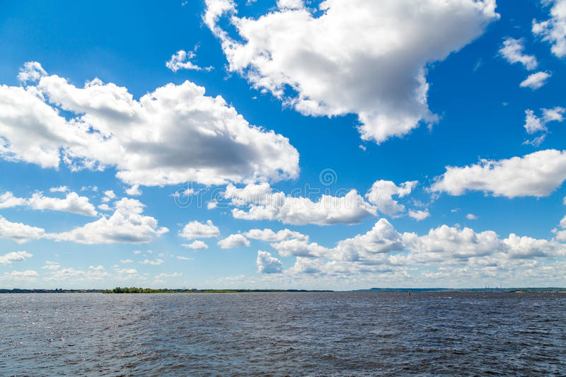 Summer river landscape. The Volga River, Saratov, Russia. Blue sky, white clouds stock images